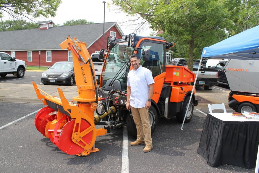 Armando Donan, product support representative of Karcher Municipal North America/Holder with the versatile Holder C70 tractor. The Holder C70 provides 40 percent more towing power and 50 percent more climbing capability than regular all-wheel drives.