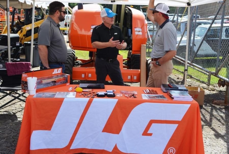 Yancey's Trey Googe (R) stops to chat with the vendors in attendance, including Josh McKinney (L) and Jay Leathers of JLG.