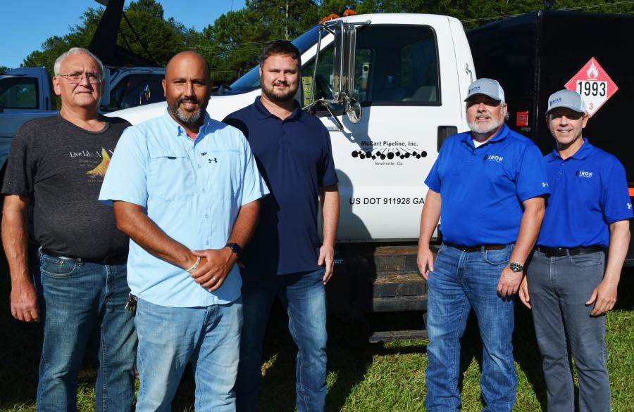 (L-R): McCart Pipeline's Doug Lee, P.J. Silva and Doug Brown prep for the sale with Iron Auction Group's Matt McGaffee and Mike Finley.