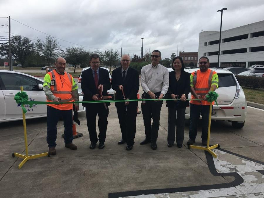 Eliza Paul (second from R) takes part in a ribbon-cutting ceremony for one of the many projects she oversaw in Texas.