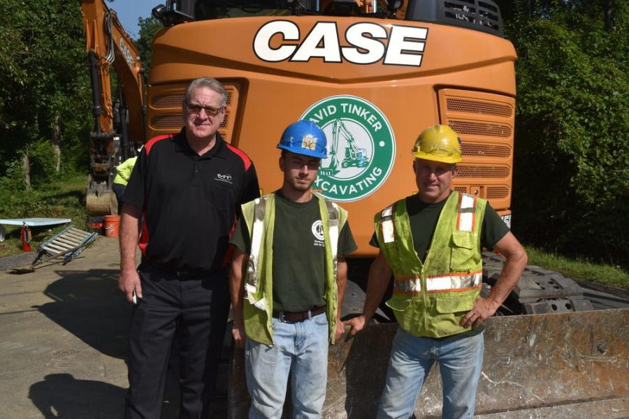 (L-R): Chris Reseska, branch manager of Monroe Tractor; and Andrew and David Tinker, both of David Tinker Excavating.