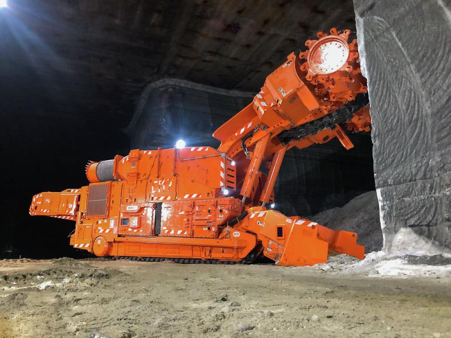 A 12HM46 continuous miner operates underground.