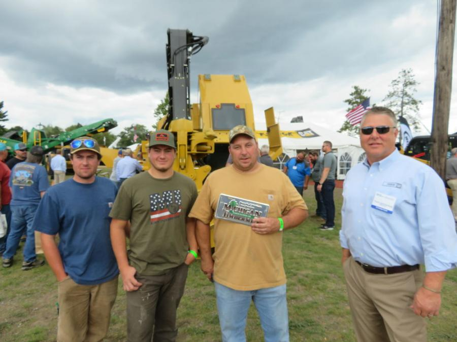 (L-R): Trevor LaChance, Mason LaChance and Al LaCosse, all of V. LaCosse Logging, talk with Todd Gustafson of Fabick CAT about this Weiler 157 harvester.