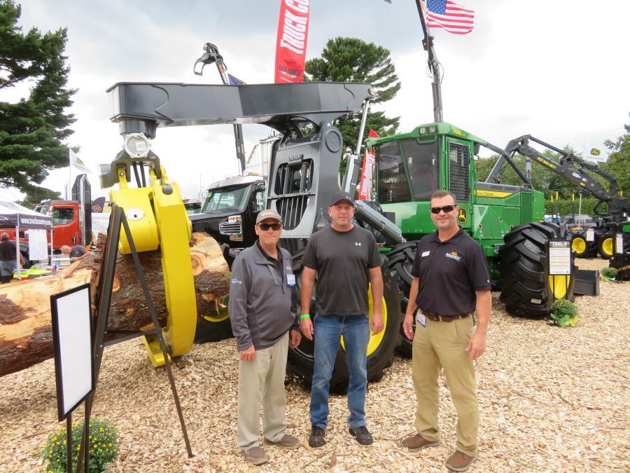 (L-R) are Matt Hanson of McCoy Construction & Forestry; Mike Miskovich of MM Timber Harvesting; and Dale Gessell of McCoy Construction & Forestry with a John Deere 768L-11 grapple skidder.