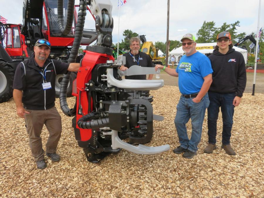 (L-R): Brad Jackson and Ed Harris of Roland Machinery Company introduce the Komatsu 931 harvester with a Komatsu C144 harvesting head to Dave and Marvin Nelson of Nelson Forest Products.