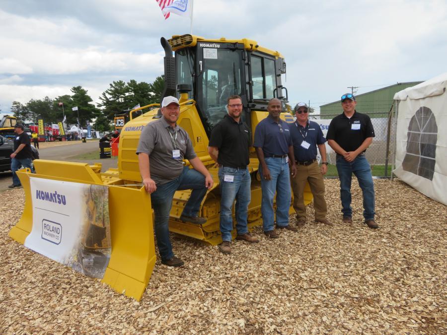 (L-R): At the GLTPA Expo with the Komatsu D39PX dozer are Jeremy Boettcher of Roland Machinery Company; Tim Schmidt of Roland Machinery Company; Raleigh Floyd of Komatsu; Marcus Steigerwaldt of Komatsu; and Scott Barnhart of Roland Machinery Company.