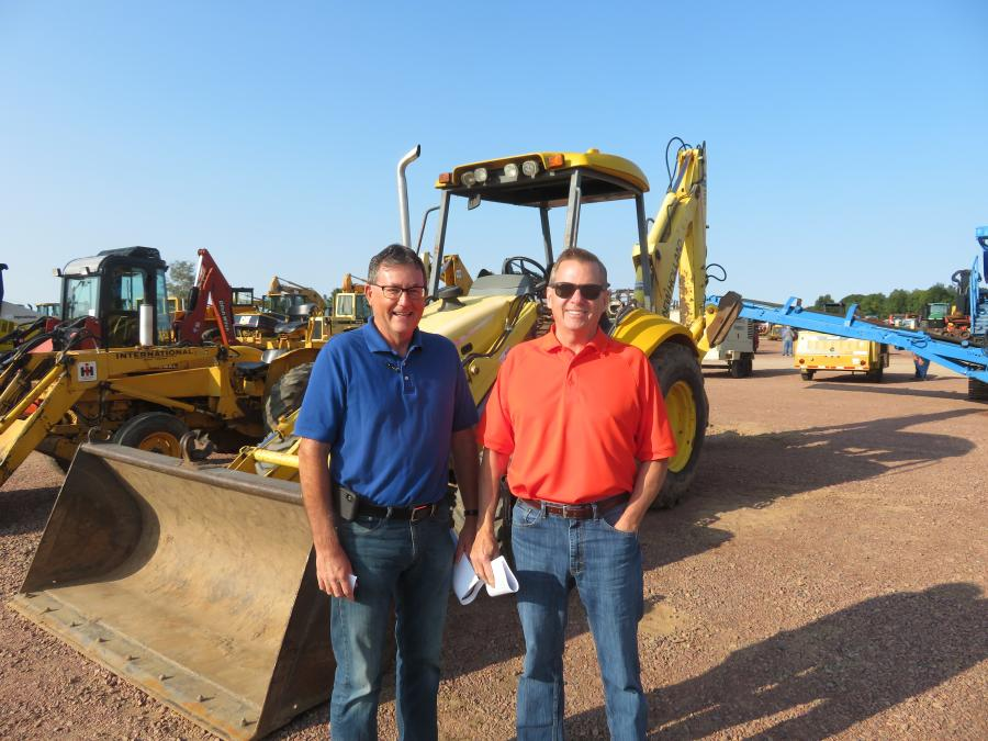 Sly Krautkramer (L), COO, and Tom Nitscke, GM, both of Swiderski Equipment Inc.  of Waupaca, Wis., were interested in this New Holland LB110.