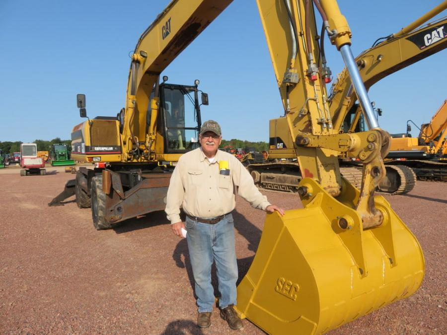 Checking out this Cat 318 wheeled excavator is Chuck Foldy.