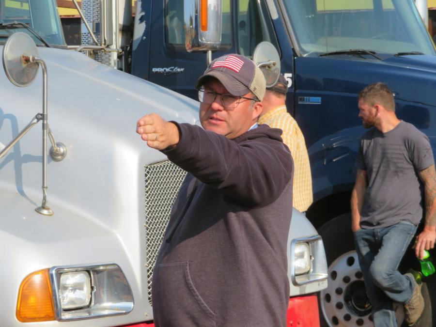 Ringman Bryan Mergen of Wausau Auctioneers scans the crowd for more bids on the trucks.