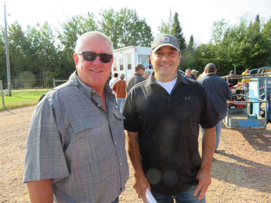 Perry Wilkinson (L) of Wilkinson Auctioneers and John Theorin of Wausau Auctioneers meet up at the auction.