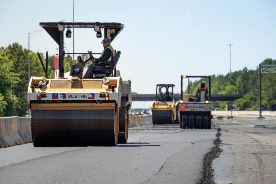 Asphalt paving operations in the medians of the I-485 Express Lanes project in southern Mecklenburg County. The newly paved surfaces will become variable-toll express lanes and general purpose lanes along the 18-mi.-long project zone.