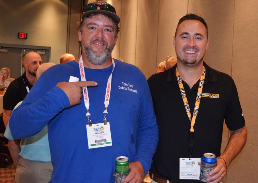 Bill Vanderbent (L) of Tree Taxi LLC, based in Riverview, Fla., bought a JCB 407 wheel loader four months ago from his Briggs JCB salesman, Billy Burr, and is expecting delivery of his second JCB machine the week after the landscape show.