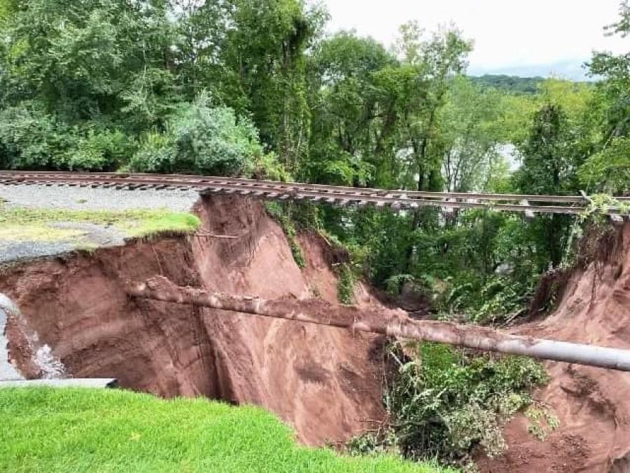 A massive sinkhole opened up following storm Ida, leaving the railroad tracks in the air near the 13th hole at the TPC at River Highlands in Cromwell. (IAFF Local 4662 photo)