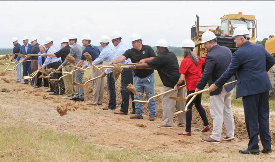 Lawmakers, city and county officials and dignitaries throw the first shovels of dirt during the groundbreaking ceremony for the Southwest Crestview Bypass. (Michael Snyder/Northwest Florida Daily News photo)