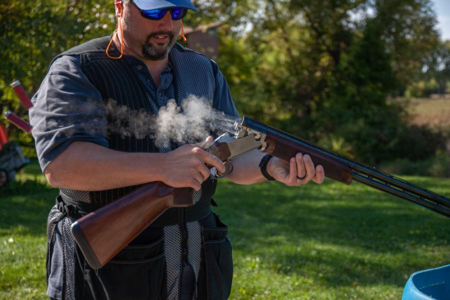 Mike McShane of Northern Dewatering ejects shotgun shells between shots.