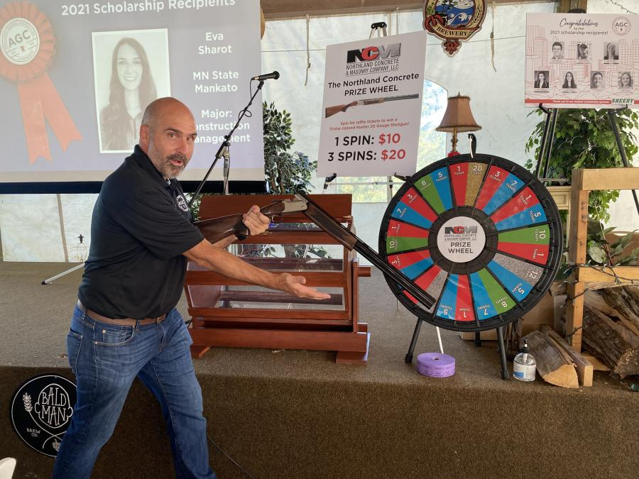 New this year: a prize wheel sponsored by Northland Concrete & Masonry Company. Participants spun the wheel for raffle tickets to win a Tristar shotgun.