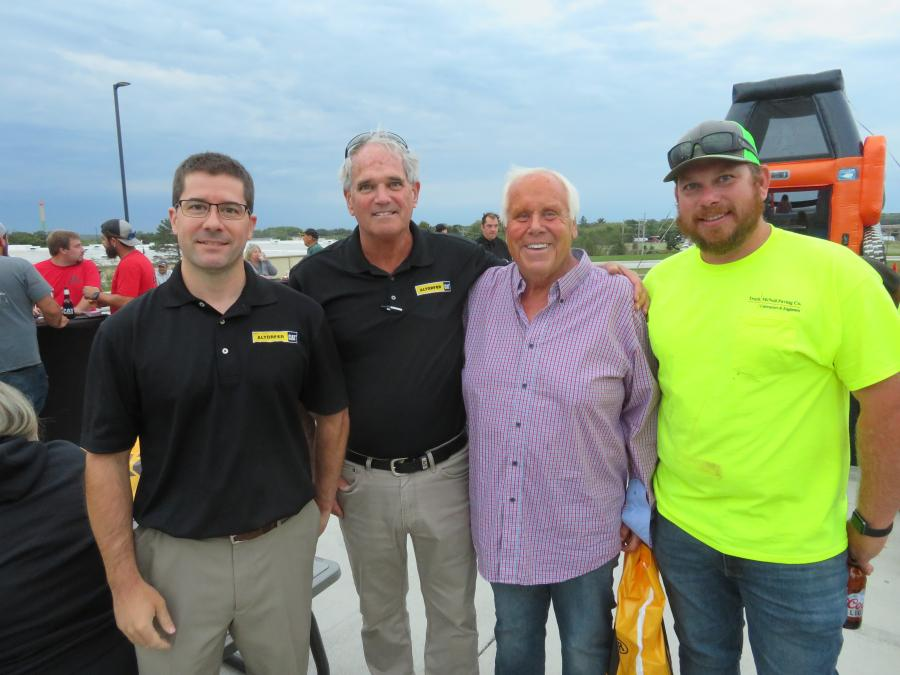 (L-R): Derek Altorfer, president Altorfer Cat, and John Loftus, sales representative of Altorfer Cat, welcome Ken and John Nordgren of Troch McNeil Paving Co. to the open house at the new facility in East Dundee, Ill.