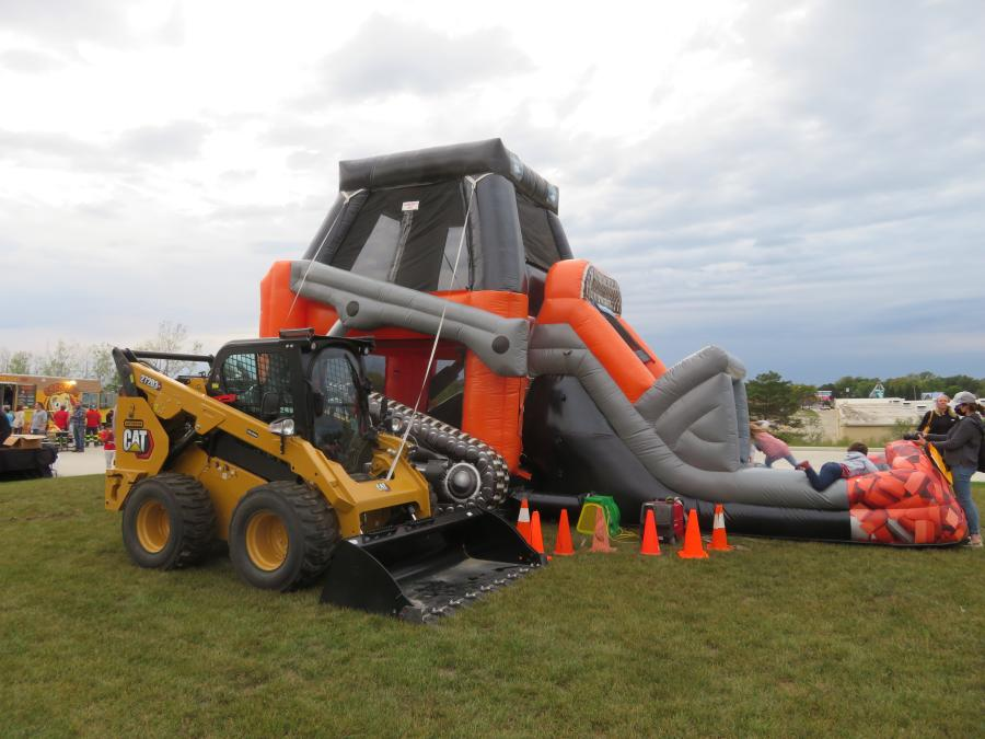 The kids played in the bouncy house, which was next to the Cat 272D3 XE skid steer purchased by Bulldog Concrete LLC.