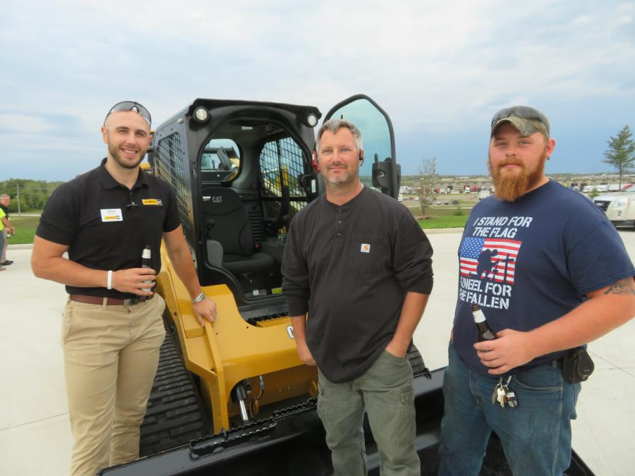 (L-R): Drew Stahl of Altorfer Cat shows this Cat 299D3 compact track loader to Ryan Horton and Zach Turner, both of the village of Lake Villa.