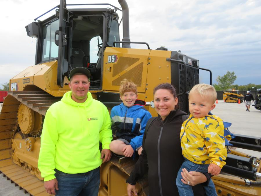 Bret Pondelick of BLP Construction brought his family to the open house. On the track of this Cat D5 dozer is his son, Joe, wife, Allison, and son, Michael.