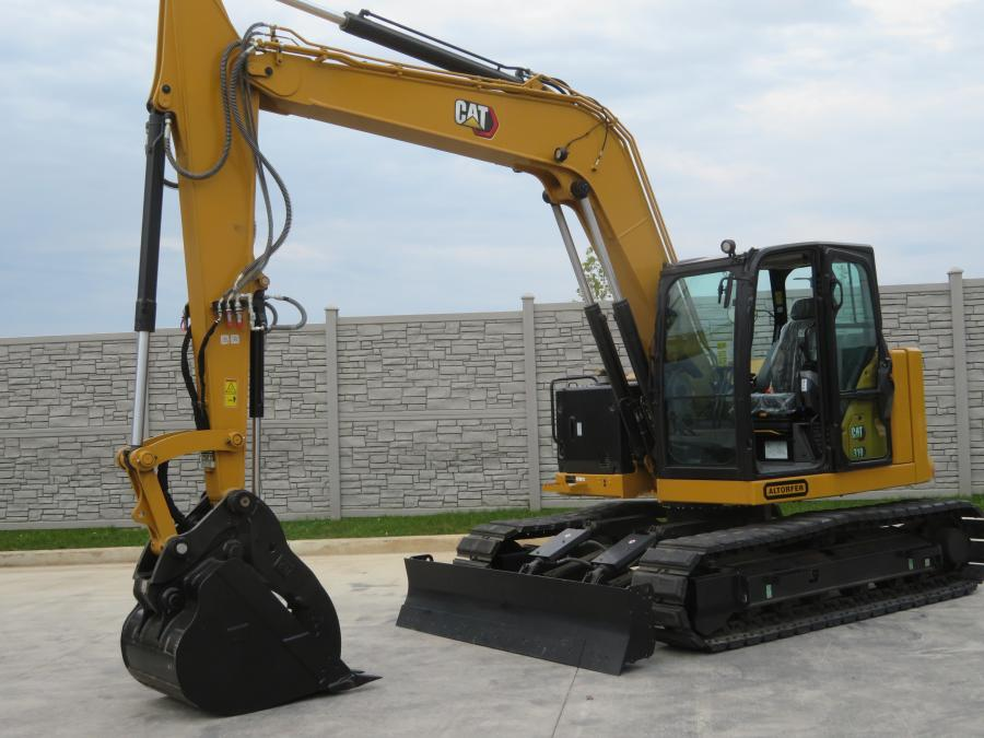 Customers had the chance to fire up this Cat 310 excavator at the open house in East Dundee.