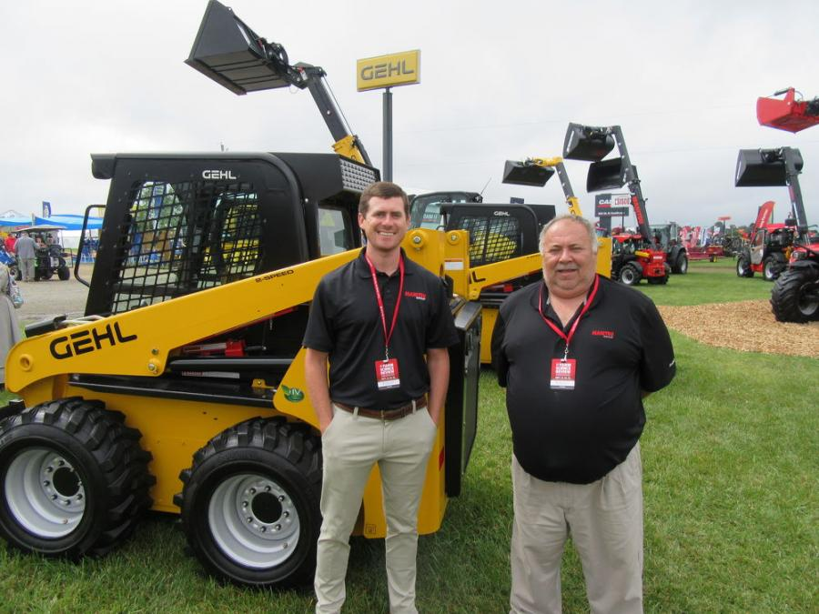 With a wide selection of Gehl and Manitou machines on display, Chase Milam (L) and John Rau of Manitou Group were ready to shine the light on the company's new Manitou MLT 841 telehandler.