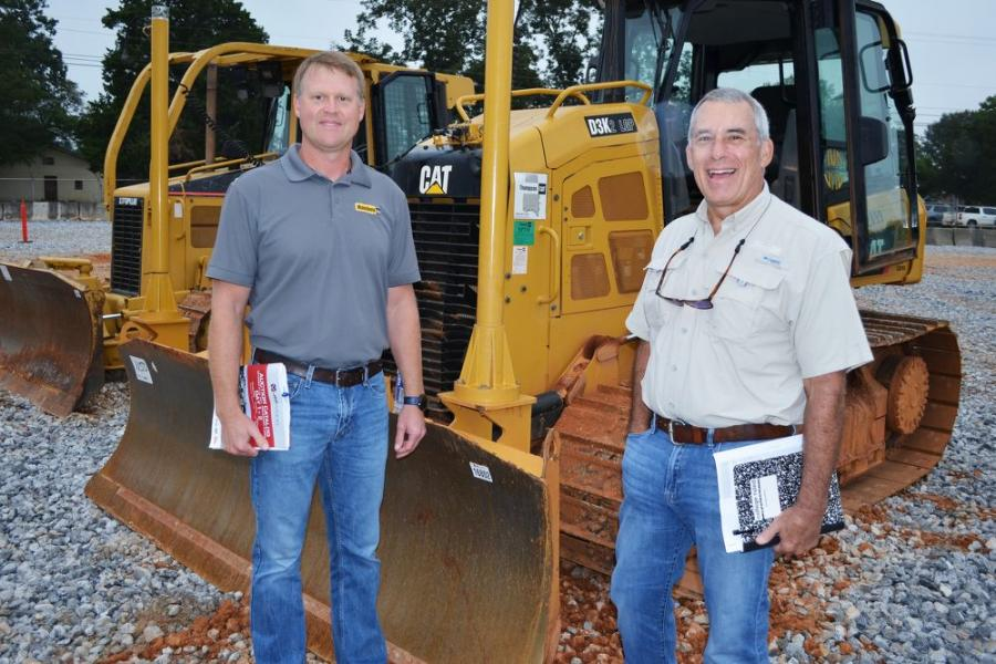 Ready to see some fast-paced auctioning on a quality lineup of machines are Blanchard Machinery's Jeff Jones (L) and Harry Hurley.