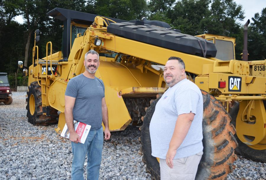 Looking over a unique piece in the sale, a Cat RM300 reclaimer that gaveled out north of $300,000, are Lee Matos (L) and John Rodriguez of Burns Construction, Stratford, Conn.