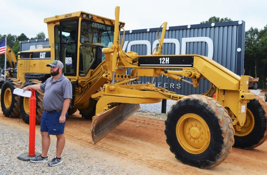 Working hard on construction equipment day, J.M. Wood's Wes Davis ushers in a gem of a machine to the ramp: a 15-year-old Cat 12H with only 1,200 hours.