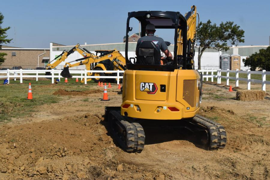 Compact excavators have become a mainstay in the equipment fleet of utility contractors across the United States.  At the Caterpillar exhibit, seat time in the Caterpillar minis was a popular option.