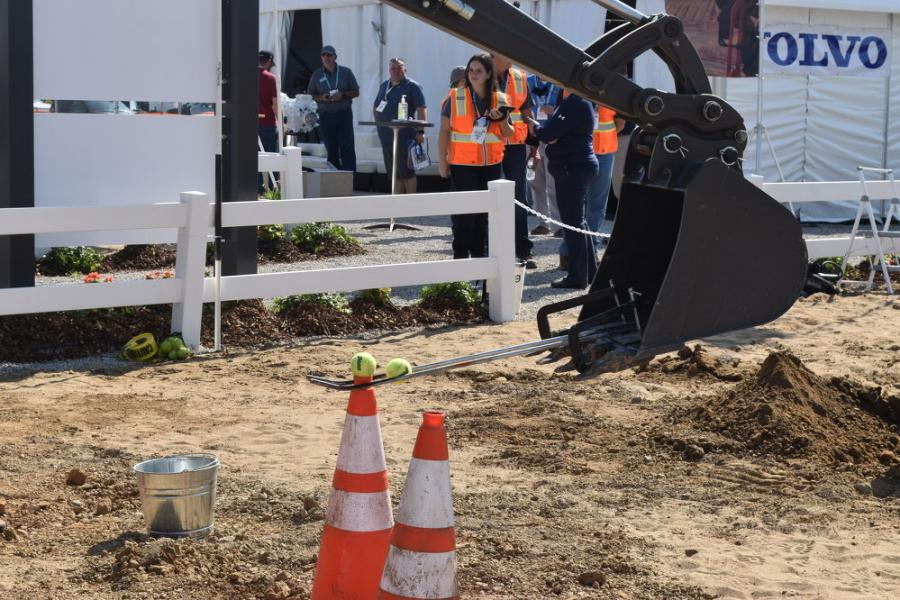 Visitors walking around the demo area of the Utility Expo could get the impression that they're visiting one big equipment rodeo. The Volvo exhibit featured a test of operator skills involving a tennis ball.