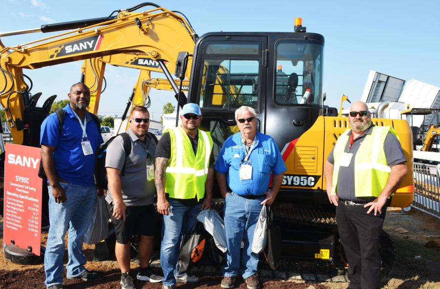 Discussing the extensive machine line-up at the SANY exhibit (L-R) are Brennis Smith, Howard Brackin, Jeff Carter and Timothy Wade of Gulf Coast Electric Cooperative, Wewahitchka, Fla., and Brady Fitzpatrick, SANY America.