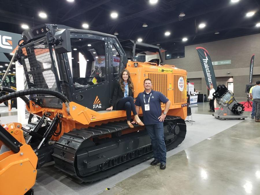 Ready to discuss the FAE PT-300 mulcher at the Utility Expo are Michelle Austin and Mike Sampels, both of FAE USA Inc.