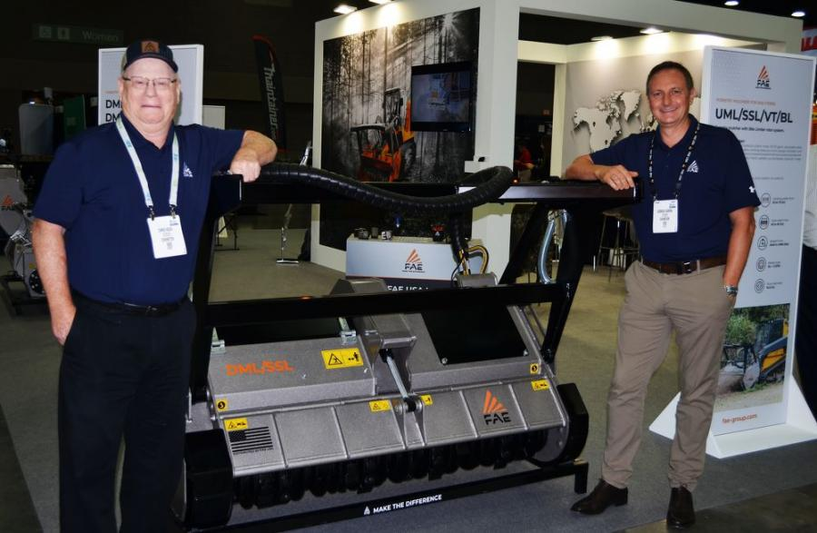 FAE USA's Chris Koch (L) and Giorgio Carera had several new products to introduce to the utility contractors, including this new DML/SSL Bite Limiter attachment for vegetation management.