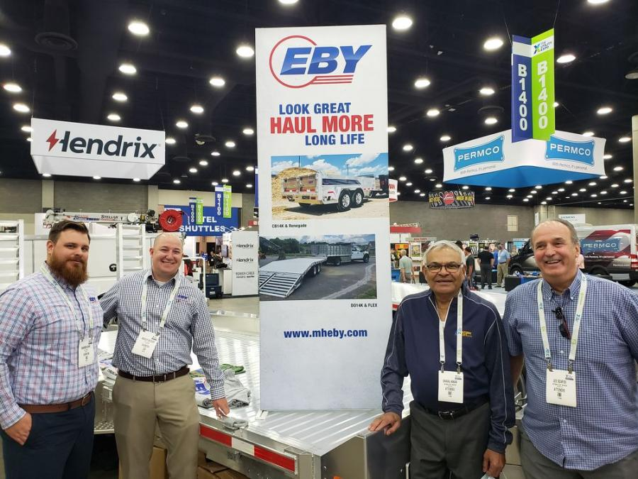At the M.H. Eby Inc. exhibit (L-R) are Brandon Rohr and Brad Kitzler, both of M.H. Eby; and Dhaval Kikani and Lee Scafidi, both of National Fleet Services, Northville, Mich.