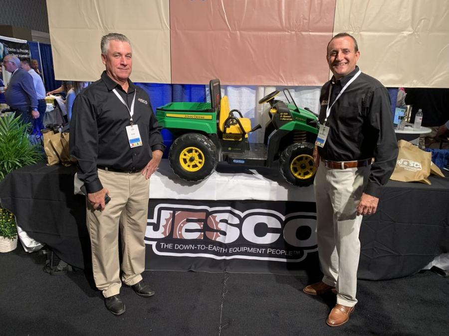 Rob Craig (L) and Anthony Falzarano, representing JESCO, show off the John Deere Toy Gator, which was auctioned off at the PAC auction during the UTCA conference.