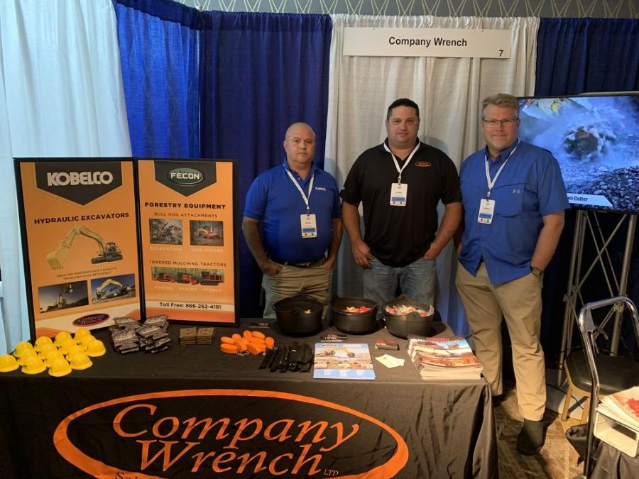 Company Wrench's Dave Manwiller, Chris DeRonde and James Bulebush show off tracked mulching trailers from Fecon and Kobelco hydraulic excavators.