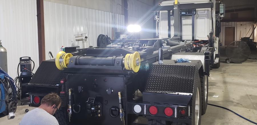 Renovations include service bays to accommodate small and large trucks. Tyler Bitker, service technician, finishes an Ampliroll hook lift with a Buyers pull plate and hitch and Buyers warning lights.