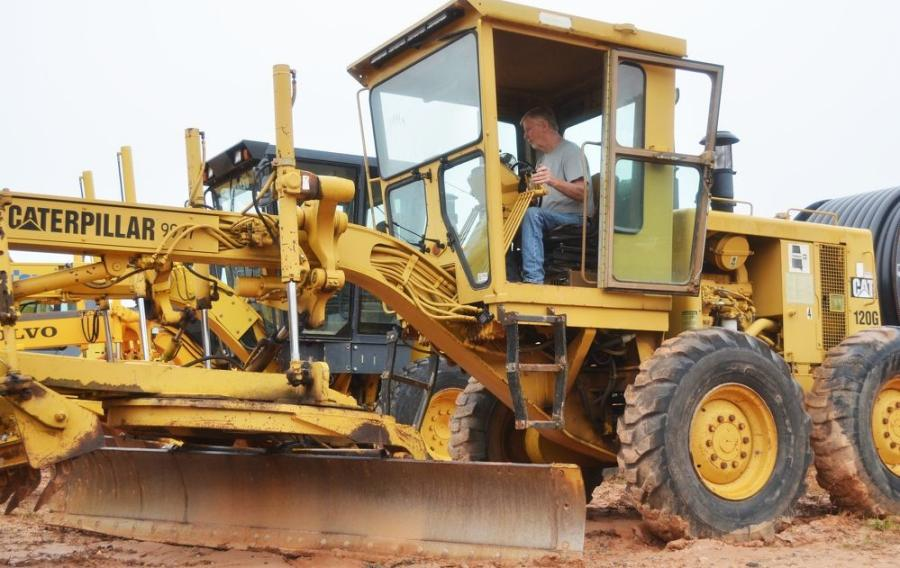 Putting a Cat 120G motor grader through the paces is Joe Howell, of J Howell Construction in Evans, Ga.