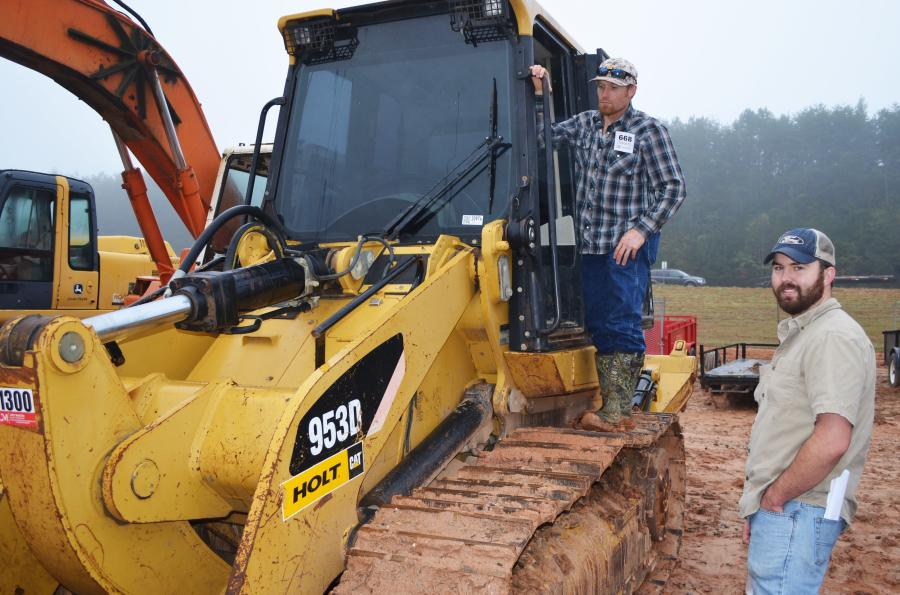 """Giving a good """"once over"""" in their inspection of a Cat 953D crawler loader are TJ Jones (L) of Bar J Farms, Talking Rock, Ga., and Ben Weatherby, independent contractor, based in Canton, Ga."""