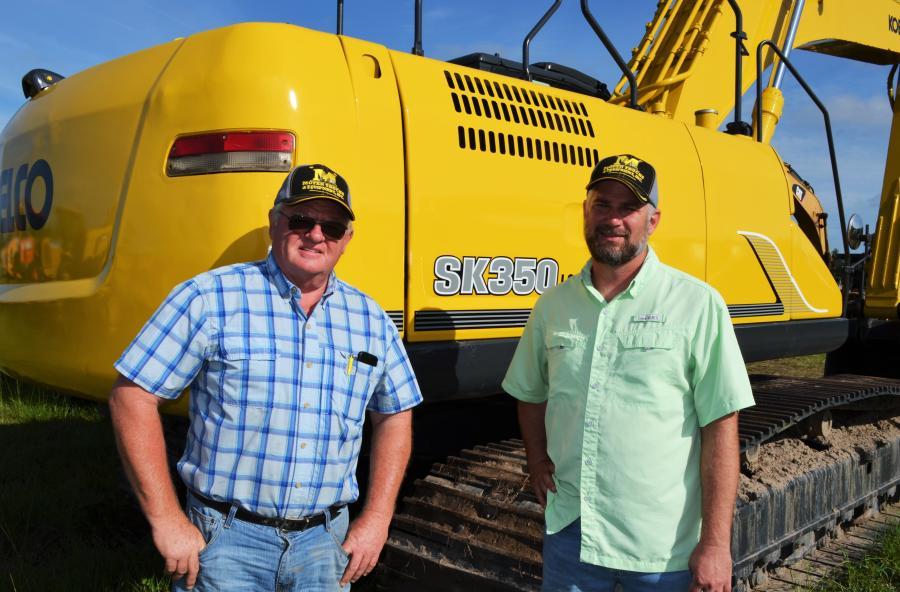 Alan Moyer (L) and Matt Mortellaro, both of Moyer Trucks & Equipment of Seffner, Fla., were spotted looking over a Kobelco SK350 of interest.