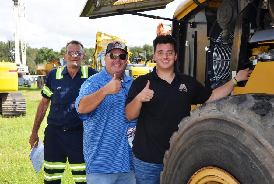 Doing some machine inspections on loaders of interest (L-R) are James Stennett, Eddie Milam and Caleb Milam, all of Milam's Equipment Sales, Sutherlin, Va.