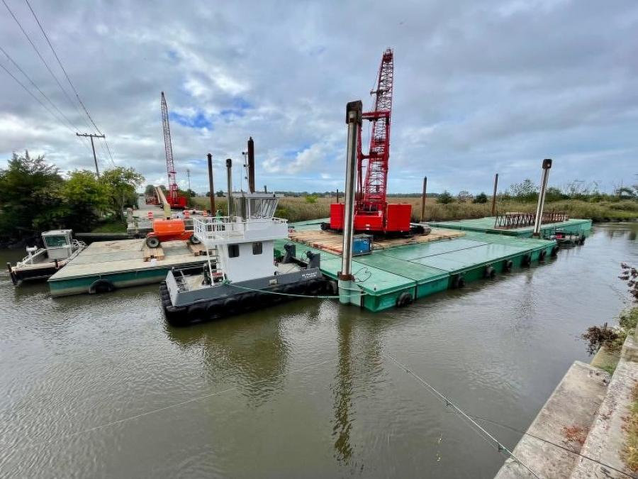 An $18 million project is under way that will see cranes, now looming over the river, dropping in 30 new, prefabricated sections of concrete deck and steel beams. (Dennis Forney photo)