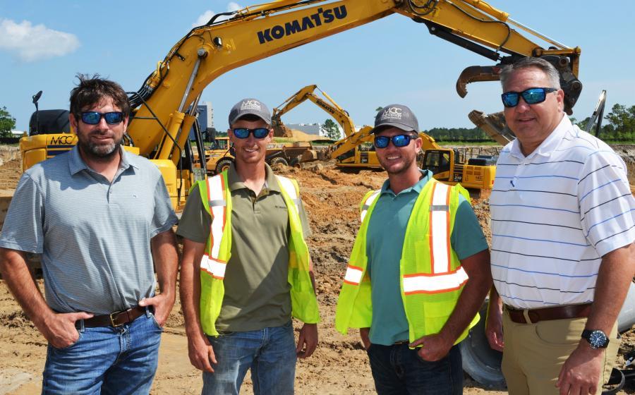 (L-R): McElhenney Construction's VP of Operations John Bush; Project Manager Greg Elmore; and Project Superintendent Matt Averett talk with TEC's Chris Howard about the Komatsu machines on the job site in Orange Beach, Ala.