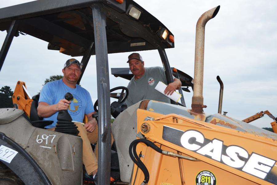Looking to snag some bargain machines to ship up to Illinois are Brett Gentry (L), Rick's Auto Sales, Metropolis, Ill., and Brian Steele, W&W Truck & Trailer Sales, Carmi, Ill.