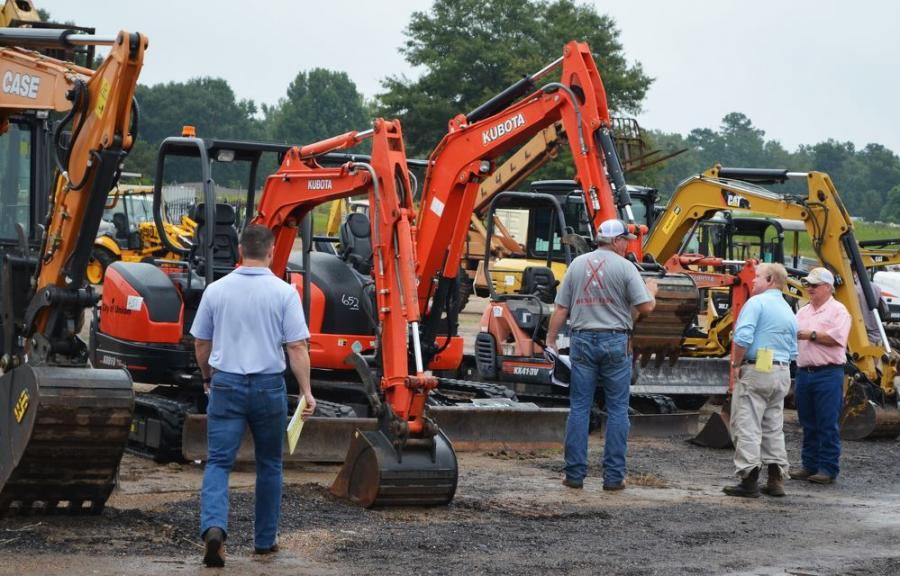 Registered bidders turned out early to inspect and discuss machines with their industry peers before settling into their seats in the auction arena.