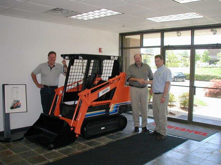 The original 1979 Takeuchi tracked machine is flanked (L-R) by Nick Grittani, Northeast factory representative of Takeuchi; Clay Eubanks, president of Takeuchi; and Gary Wade, president of All Island Equipment.